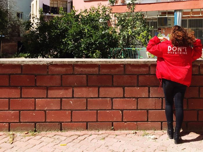 Don't overthink! Red Outdoors Brick Wall One Person Real People Day Women One Woman Only Only Women Architecture Full Length Building Exterior Tree Built Structure Adults Only Adult People женщин