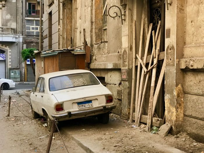 Streets of Cairo, Egypt Middle East Street Photography Africa Arabian Third World Travel Destinations Streetphotography Cairo Streets Arabic Charming Old Car Raggedy Egyptian Egypt Cairo Car City Old Street Motor Vehicle Damaged Wall - Building Feature Outdoors Day EyeEmNewHere EyeEmNewHere