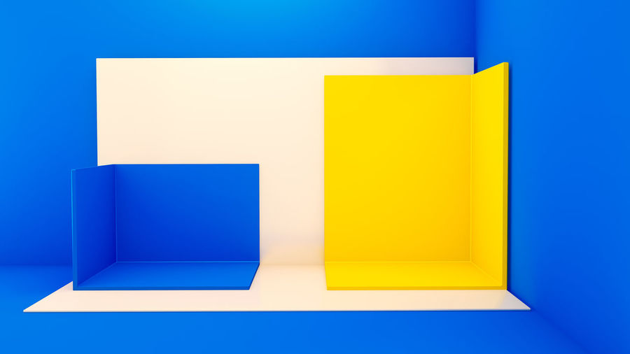 Close-up of yellow paper against blue background