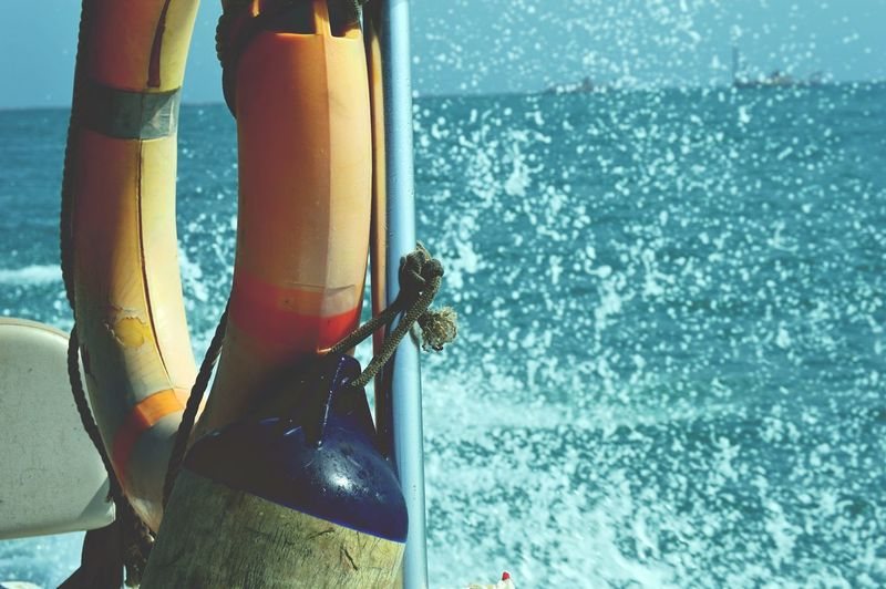 Buoy And Life Belt Tied Up On Pole By Sea
