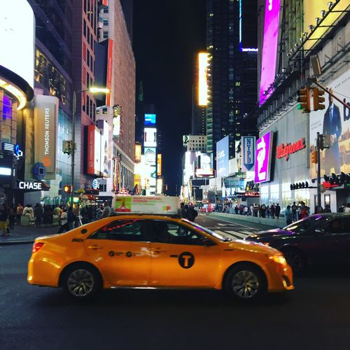 Car Illuminated Building Exterior Architecture Street City Transportation Built Structure Night Yellow Taxi Land Vehicle Travel Destinations Outdoors Neon Road No People NYC
