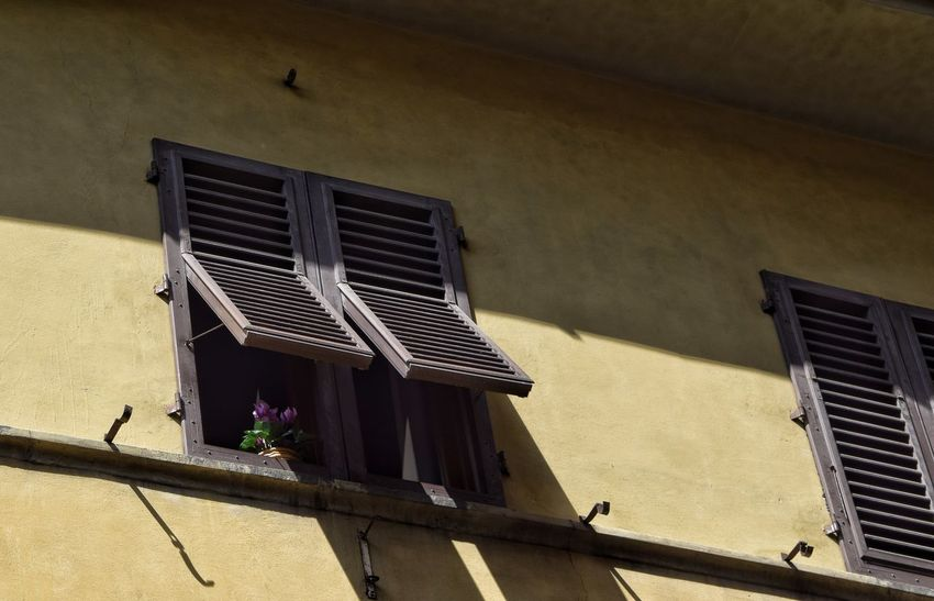 EyeEm Selects Shutters Window Shutters Building Exterior Built Structure Low Angle View Window House Air Duct Residential Building Outdoors Shadow No People Day Roof Architecture Sky Visit Italy Florence Italy Street Photography City Life The Week On EyeEm Wooden Shutters Louvered Shutters
