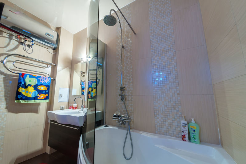 Indoors  Bathroom No People Domestic Bathroom Hygiene Illuminated Domestic Room Sink Mirror Lighting Equipment Home Hospital Healthcare And Medicine Absence Wall - Building Feature Tile Flooring Faucet Shower Furniture Ceiling