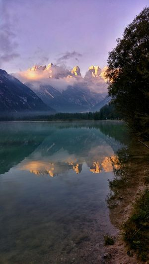 Water Lake Tranquil Scene Scenics Tranquility Sunset Mountain Tree Reflection Beauty In Nature Sky Majestic Nature Calm Cloud - Sky Non-urban Scene Standing Water Waterfront Mountain Range Growth Dolomites Italy Morning