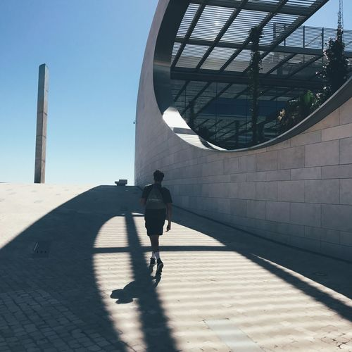 Light Shadows & Lights Walking Around Architecture Building Exterior Built Structure Clear Sky Day Full Length Leisure Activity Lifestyles Light And Shadow Men One Person Outdoors People Real People Rear View Shadow Sunlight Walking