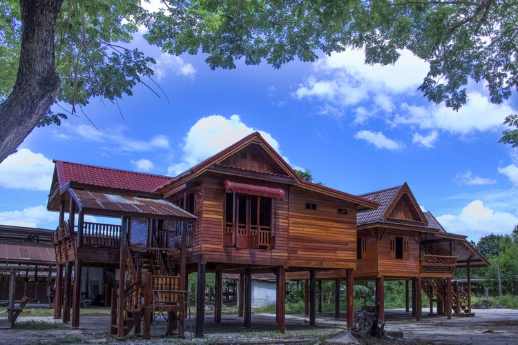 Thai house Architecture Blue Building Building Exterior Built Structure Cloud - Sky Day Field House Land Nature No People Outdoors Plant Residential District Roof Sky Tree Wood Wood - Material