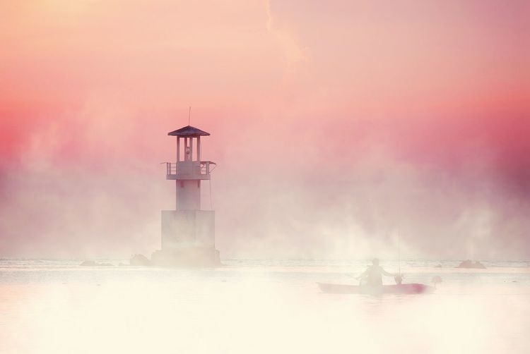 a day after Lighthouse Sunset Fog Protection Business Finance And Industry Guidance Water Safety Security Sky Atmospheric Mood Silhouette Horizon Over Water Seascape