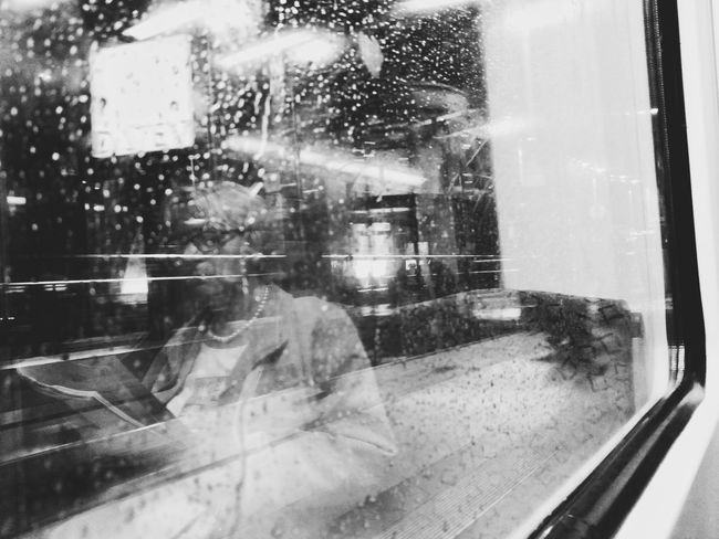 Window Water Wet Drop City Day Architecture Close-up Berliner Ansichten Streetphoto_bw Berlin Street Photography Elderly Woman Old Lady Reading On The Train Reading A Book Window Reflections City Lights Train Window Black And White Train Raindrops