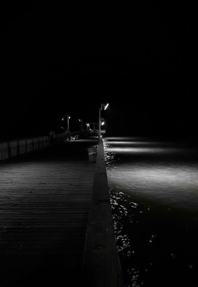 Night Water Tranquility No People Outdoors Nature Noirphotography Spooky Dreamlike South Padre Island Deck Pier Dock Of The Bay Shadows & Light Reflections In The Water High Contrast Blackandwhite Photography Boardwalk Shadow Port Isabel Tx. Dreary Can Be Beautiful