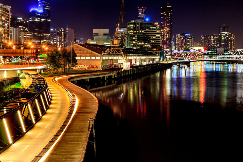 Looking back into the city from the Docklands Cityscape Architecture Building Exterior Built Structure City Illuminated Modern Night No People Outdoors Sky Skyscraper Transportation Water