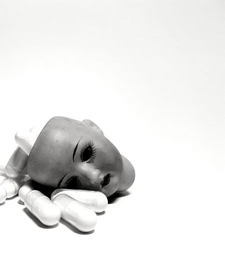 Doll Doll Photography Doll Face Psychology Burnout Clinic Blackout Healthy Healthcare Illness Ill Medical Medicine Therapeutic Therapy Tablets Pills White Background Close-up Pill Capsule Aspirin Pill Bottle Prescription Medicine Antibiotic Taking Medicine Dose PainKiller Homeopathic Medicine Vitamin