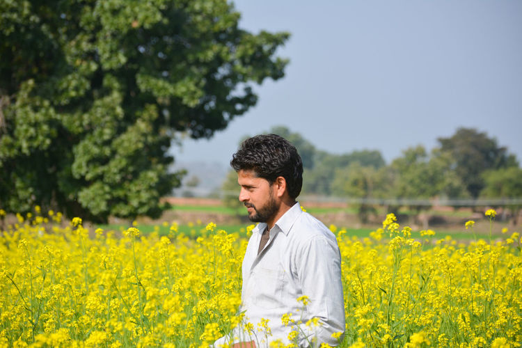 Young man standing in field