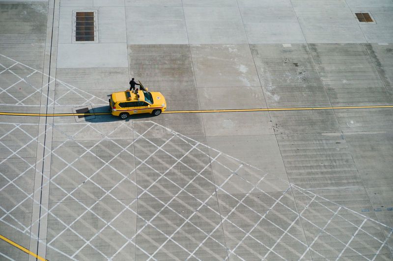 Industry Transportation Yellow Occupation One Person High Angle View Working Construction Industry Architecture Day Airport Development Safety Mode Of Transportation Adult Protection Outdoors Men