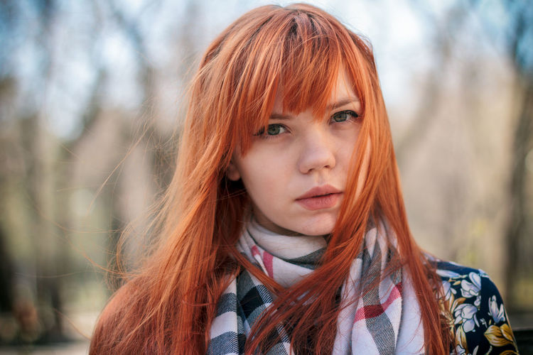 Close-Up Portrait Of Young Woman Standing Outdoors