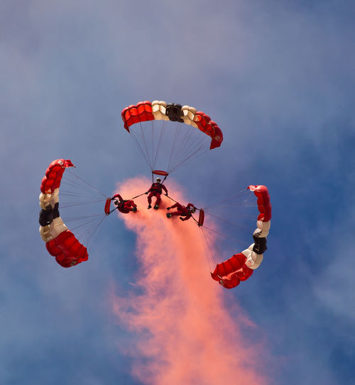 The Red Devils Display Team Extreme Sports Flying Leisure Activity Lifestyles Low Angle View Mid-air Outdoors Parachute Real People Sky