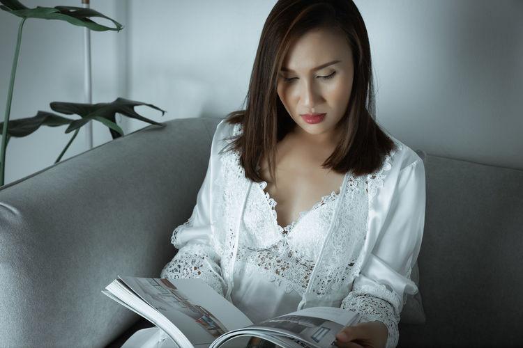 Asian women reading book