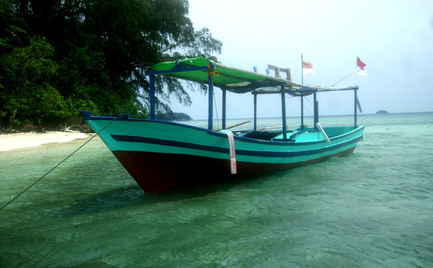Fisherman Ship Boat Boat And Sea Boats⛵️ Island No People Ocean Photoshoot Sea Sea And Sand Ship Ships⚓️⛵️🚢 Transportation Recreation Area Things Around Me Fisherman Traditional Transportation Trvelling Boat Photography Sailboat Transportation People Ship At Sea