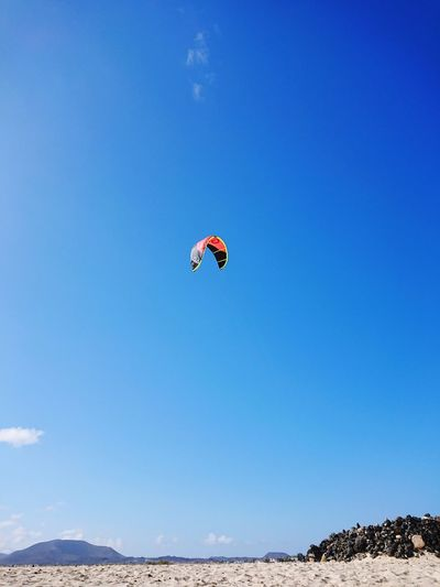 For fun Coastline Perspective Sandy Beach Kite Blue Sand Sand Dunes Colour Extreme Sports Parachute Flying Full Length Sport Mid-air Adventure Jumping Motion Gliding Fly Aerobatics