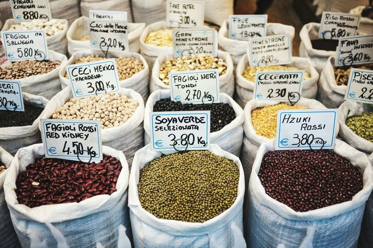 High Angle View Of Various Pulses With Price Tag At Store