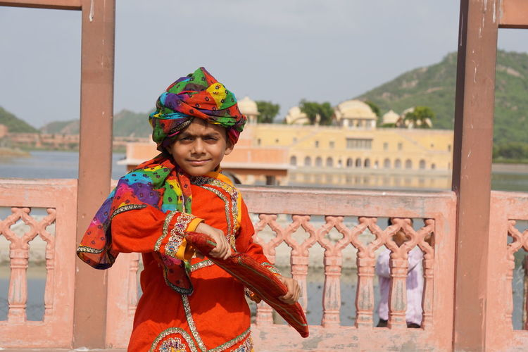 EyeEm Selects Traditional Clothing Jewelry One Person Adults Only Portrait Outdoors Day Water Sky Enjoy The Little Things Jaipur Tourist Place Reflection Cityscape Enjoy The Moment Getty Images Jaipur Rajasthan Old Ruin Scenics Architecture History Travel Destinations King - Royal Person Jal Mahal Child