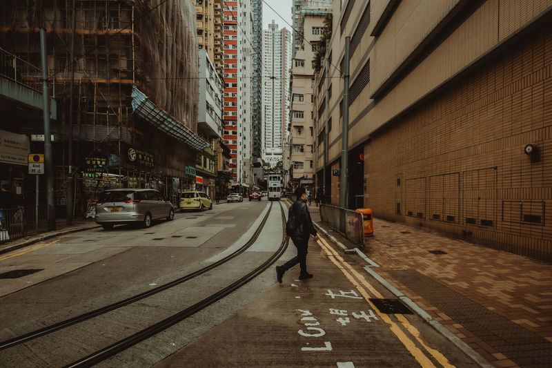 hongkong street City Architecture Building Exterior Transportation Built Structure Street Mode Of Transportation Motor Vehicle Road Building Car Land Vehicle The Way Forward Direction One Person City Life Real People Sign Walking Incidental People City Street Outdoors Office Building Exterior HongKong The Architect - 2019 EyeEm Awards The Traveler - 2019 EyeEm Awards