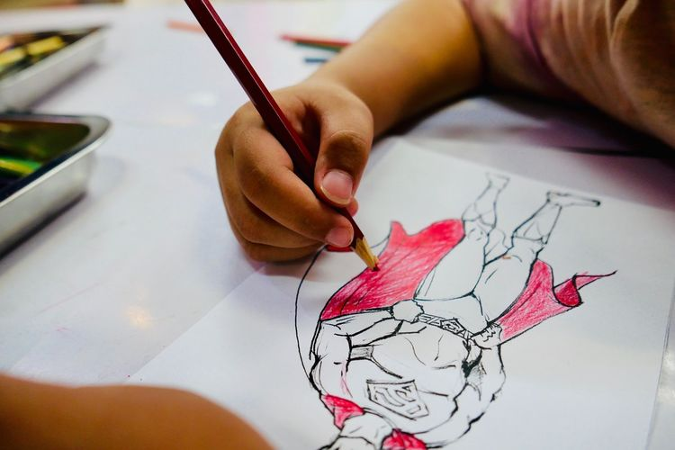 Colors Art And Craft Creativity Drawing - Art Product Drawing - Activity One Person Paper Indoors  Human Hand Hand Human Body Part Holding Real People Leisure Activity Pencil Child Finger High Angle View