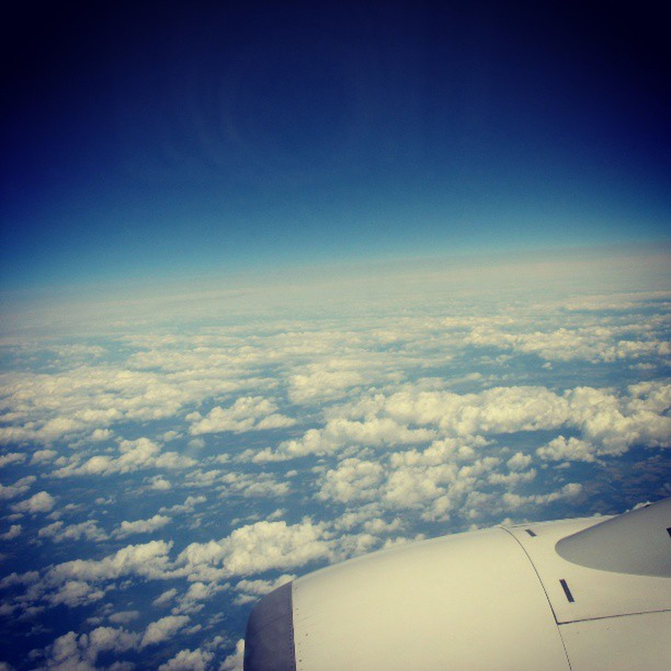 airplane, air vehicle, flying, aircraft wing, part of, sky, transportation, mode of transport, aerial view, cropped, cloudscape, cloud - sky, blue, scenics, mid-air, beauty in nature, journey, cloud, nature, aeroplane