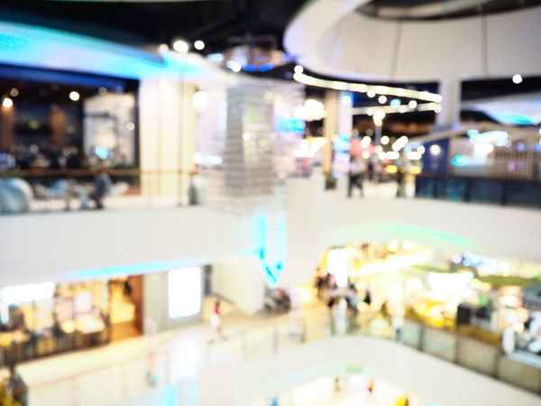 Blurred interior of shopping mall. The modern building concept. Illuminated Incidental People Architecture City Group Of People Built Structure Transportation Indoors  Lifestyles Shopping Mall Real People Defocused Blurred Motion Night Women Adult People Street Motion Consumerism Light Luxury