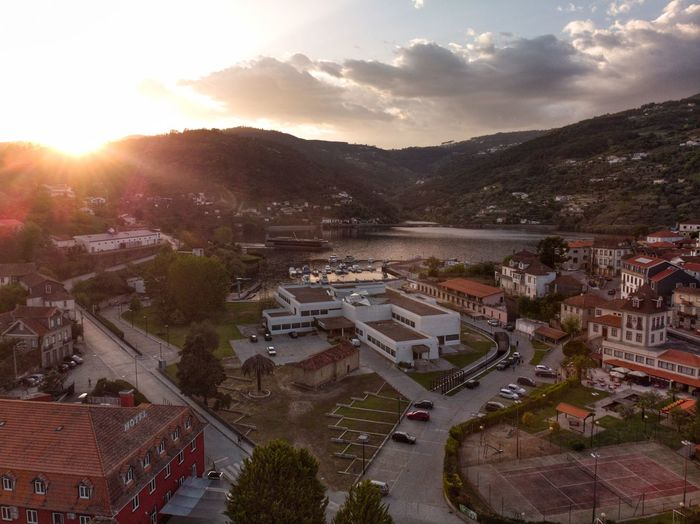 Sunset over the village DJI X Eyeem DJI Mavic Air Drone Photograph Aerial Portugal Douro  Douro Valley Architecture Building Exterior City Built Structure High Angle View Building Cityscape Transportation Town Travel Destinations Plant Sunset House Outdoors No People Residential District Cloud - Sky Sky Tree Nature
