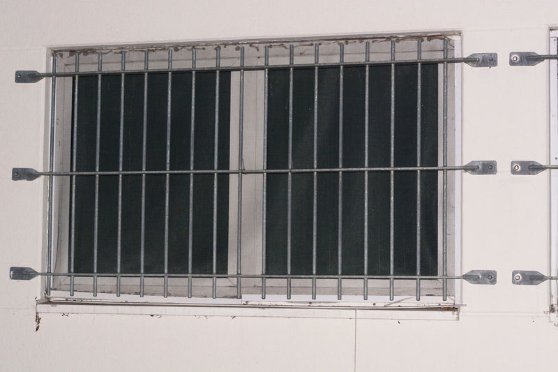 Installation of window grid of metal as protection against intruders. Security grille for windows, doors and balconies. Architecture Crimea Day Lattice No People Outdoors Prison Trapped House Window Window Grilles Windows