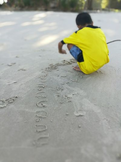 Boy Boy Playing Write On Sand Child Childhood Full Length Yellow Males  Wet