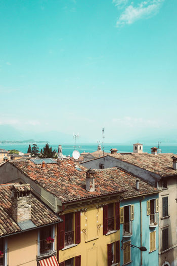 Rooftops over Lake Garda 🏘️ Italy Italia Italy❤️ Italy🇮🇹 IT Lake Lake Garda Lago Di Garda Italy Photos Sea Roof Beach Sky Architecture Building Exterior Horizon Over Water Built Structure Roof Tile Rooftop Town Antenna - Aerial TOWNSCAPE Residential Building Residential Structure The Architect - 2018 EyeEm Awards The Traveler - 2018 EyeEm Awards