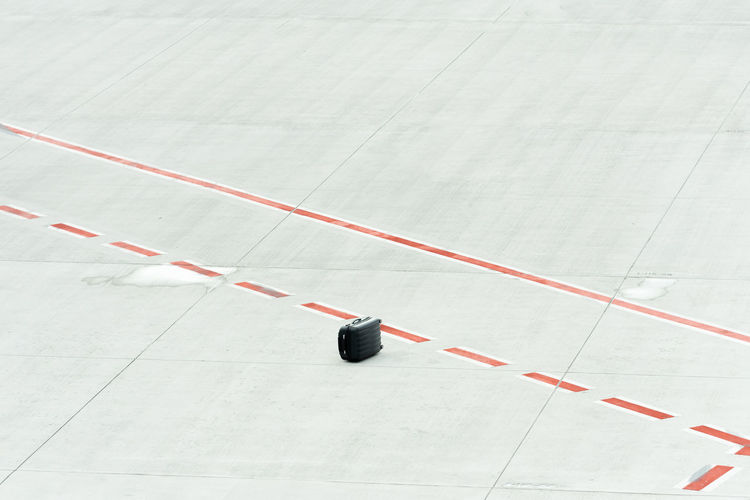 High angle view of suitcase on airport