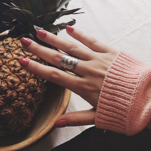 High angle view of woman hand touching pineapple