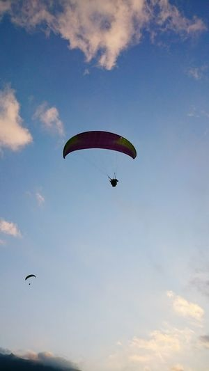Flying Mid-air Paragliding Parachute Sky Outdoors Low Angle View Leisure Activity Full Length Motion Nature Day Bird People Extreme Sports One Person Spread Wings Animal Themes Adult Stunt Person EyeEm Selects