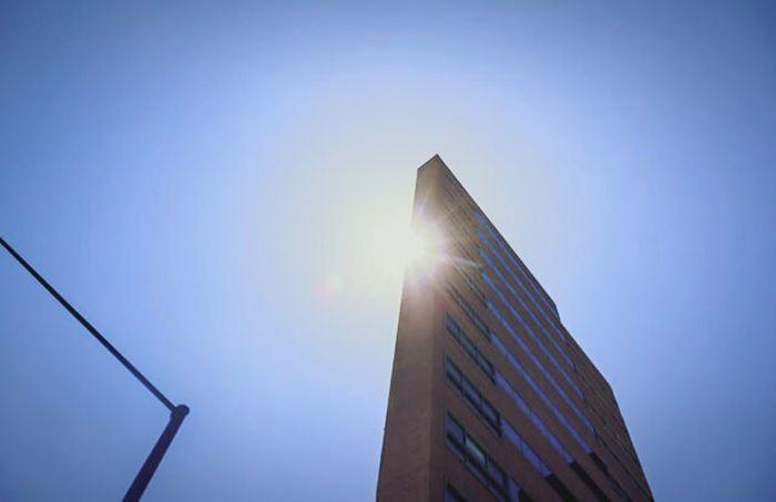 """Another architectural phallus rapes the skyline"" (2016) Denver, Co Architecture Photography Sunburst Outdoor Photography Phallic Symbol Progress? Man Versus Nature Dark Humor"