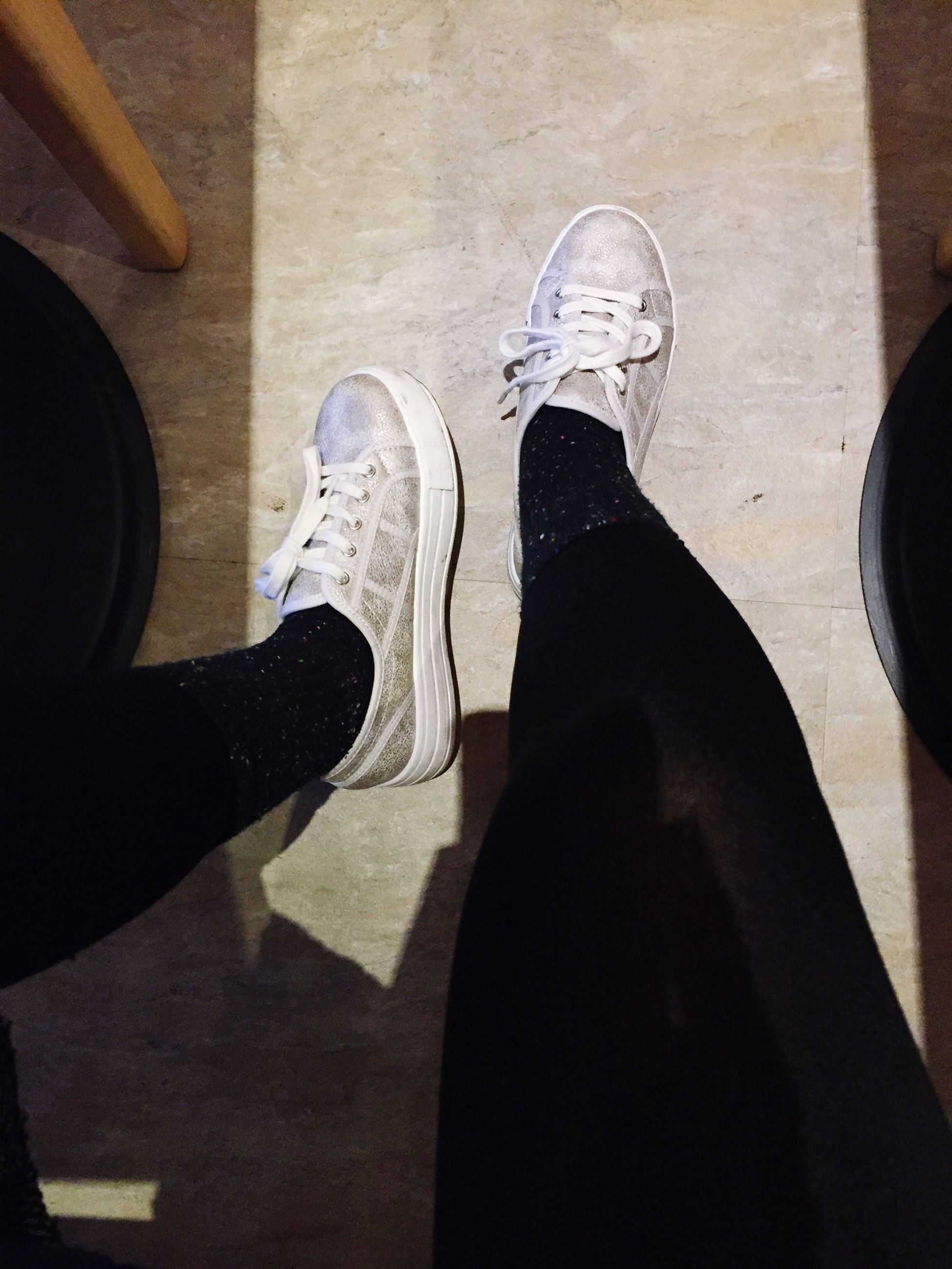 low section, person, shoe, indoors, lifestyles, personal perspective, standing, footwear, men, jeans, human foot, leisure activity, flooring, high angle view, sitting, casual clothing