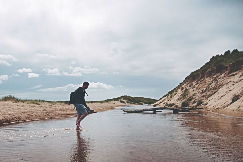 Balmedie Beach Full Length One Man Only One Person Adult Cloud - Sky Beach Walking Standing Tranquility Outdoors Discovery Landscape Sky One Young Man Only Sea Scotland Balmedie Balmedie Beach Aberdeenshire Coast Ocean Standing People Beauty In Nature Sand Dune