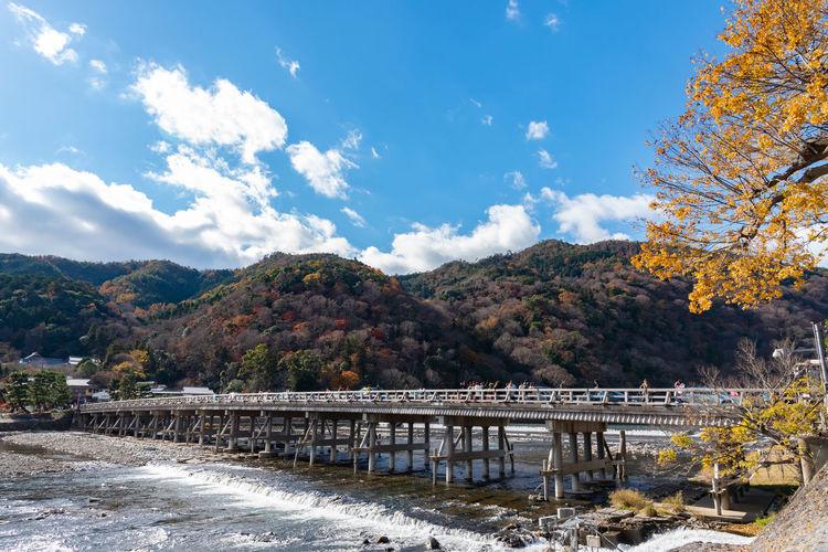Bridge over mountain against sky during autumn
