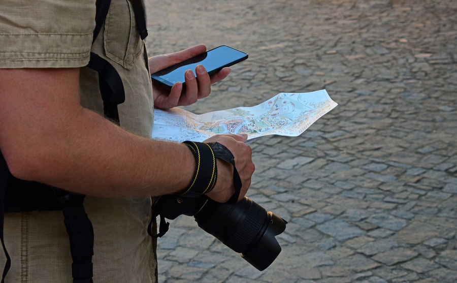 Tourist, paper city map, phone and camera Camera City Map Tourist Travel Travel Photography Traveling Your Ticket To Europe Close-up Europe Holding Human Hand Map Men One Person Outdoors Paving Stones Phone Real People Stone Road Technology Tourism Tourist Destination Travel Destinations Vacations Way An Eye For Travel Stories From The City Focus On The Story