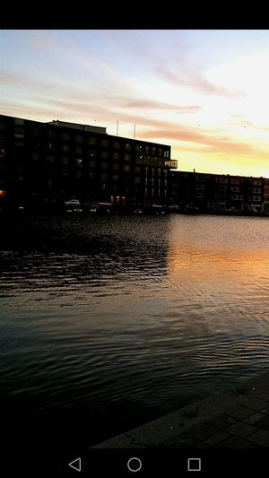Water Reflection Sunset Architecture Outdoors Built Structure Waterfront Sky Building Exterior Lake No People City Nature Day