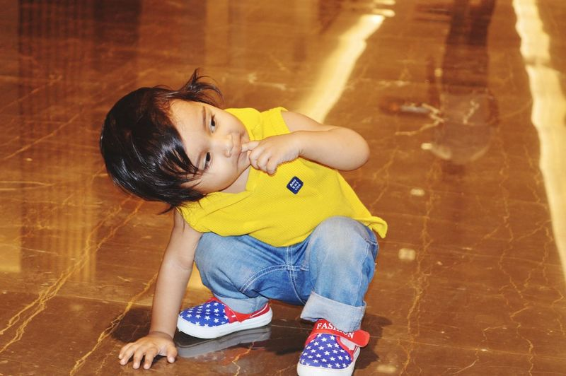 High angle view of girl sitting on floor
