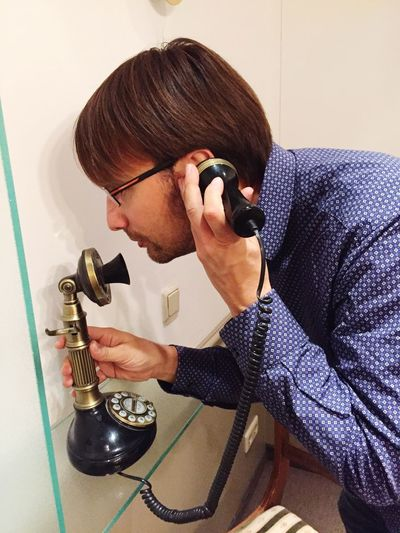 Man talking on telephone at home