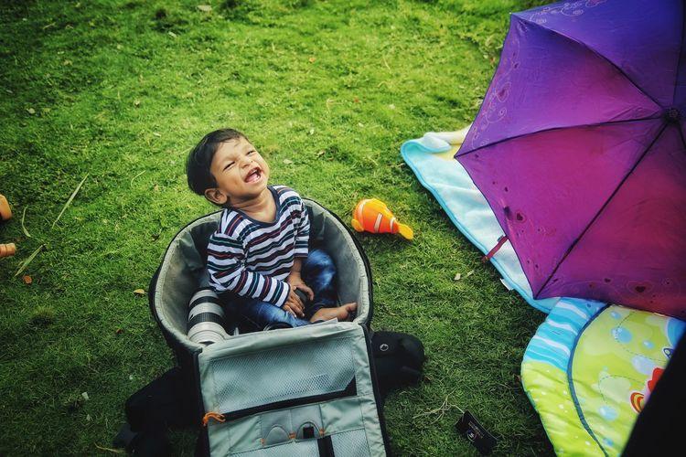 Full length of smiling boy on grass