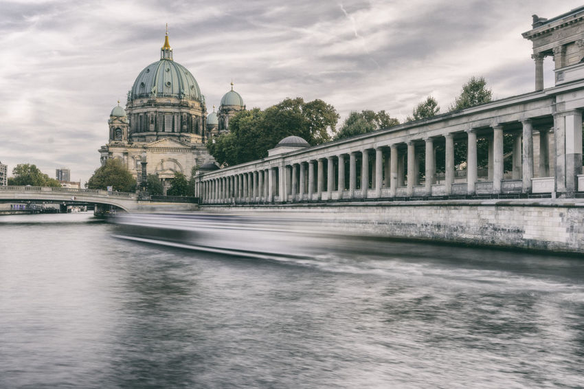 Spree River at Berlin Cathedral with tourist cruise boat Arcade Architecture Architecture Berlin Cathedral Berliner Dom Bridge - Man Made Structure Building Exterior Built Structure Cathedral City Cloud - Sky Colonnade Connection Dome Outdoors Pillars Place Of Worship Religion River Sky Spirituality Spree River Berlin Tourist Attraction  Water Waterfront