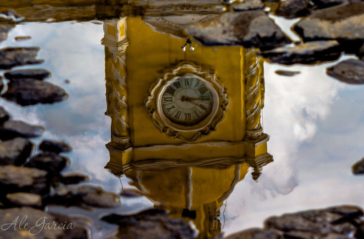 Clock Clock Tower Close-up Eye4photography  EyeEm EyeEm Gallery EyeEmBestPics Focus On Foreground Outdoors Reflection Reflection_collection Reflections Reflections In The Water Reflejos Reflejos En El Agua Reflex Reloj Selective Focus Sky Tiempo Time Tourism Travel Destinations