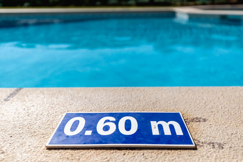High angle view of information sign by swimming pool