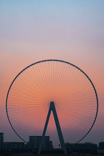 Silhouette ferris wheel against sky at sunset