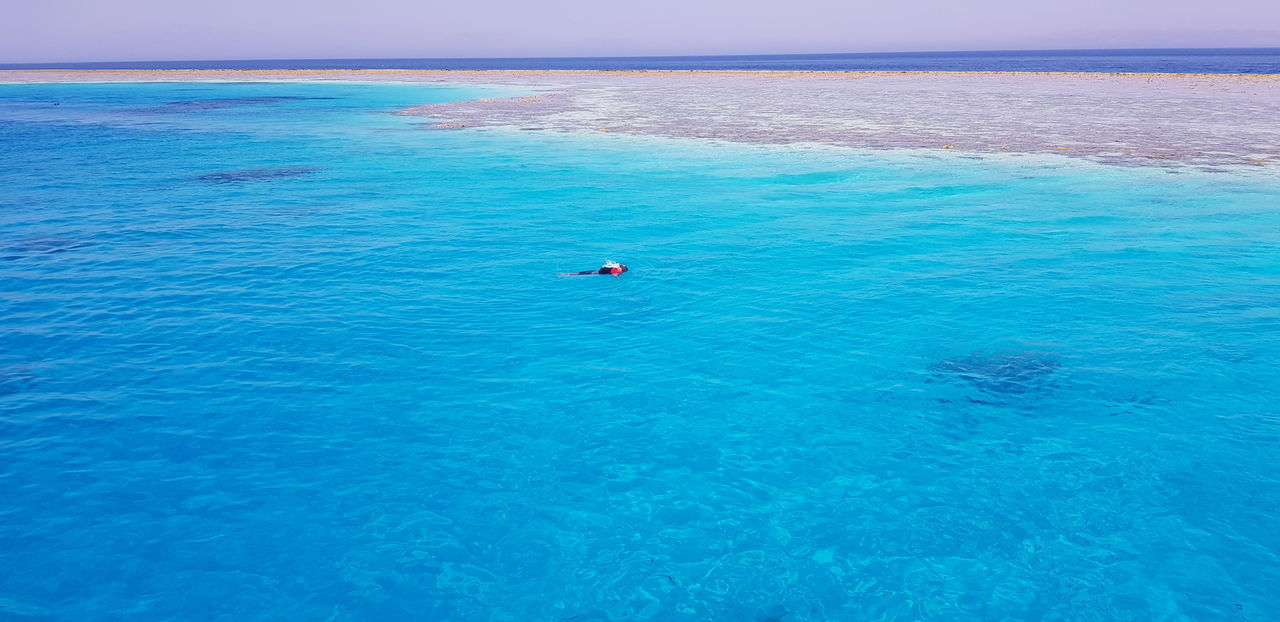 Water Sea Beach Beauty Blue Paddleboarding Swimming Summer Clear Sky Wave Shore Coastline Snorkeling Seascape Tide Scuba Mask Underwater Diving Ocean Rocky Coastline Coast Horizon Over Water Surf Idyllic Low Tide Diving Flipper Coastal Feature Turquoise Turquoise Colored Lagoon Reef The Great Outdoors - 2018 EyeEm Awards