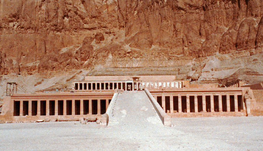 Queen Hatshepsut's mortuary Temple at Deir el-Bahri - Valley of the Kings, Luxor, Upper Egypt. A daughter of King Thutmose I, Hatshepsut became queen of Egypt when she married her half-brother, Thutmose II, around the age of 12. Upon his death, she began acting as regent for her stepson, the infant Thutmose III, but later took on the full powers of a pharaoh, becoming co-ruler of Egypt around 1473 B.C. A Taste Of Egypt Egyptology Howard Carter Luxor,Egypt Queen Hatchepsut Temple Tutankamun Ancient Ancient Thebes Ancient Civilization Archaeology Architecture Building Exterior Built Structure Day Deir El Bahri History Indoors  No People Old Ruin Rock - Object The Past Travel Destinations Valley Of The Kings